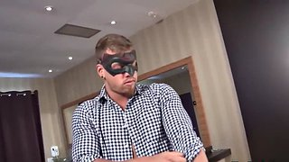 Masked muscled stud pumping his cock