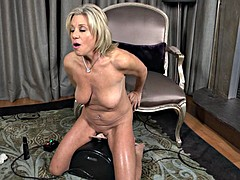 Milf mature naked blonde sits in her favorite dildo