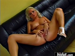 busty blonde stuffs her asshole on the couch