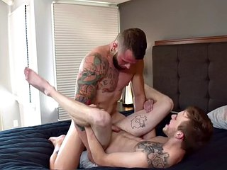Tattooed jock sucks and rides muscular top until she squirts with cum