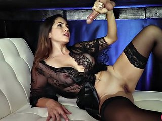 Lingerie babe with big tits jerks off a cock under the table