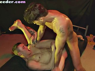 Ripped tattoo jock sucks while getting drilled in a raw duo