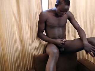 African jock fingers her ass while pulling uncut cock