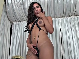Curvy Latina trans babe jerks off dick and toys her ass