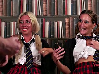 Uniformed British voyeurs watch teacher pull in her office